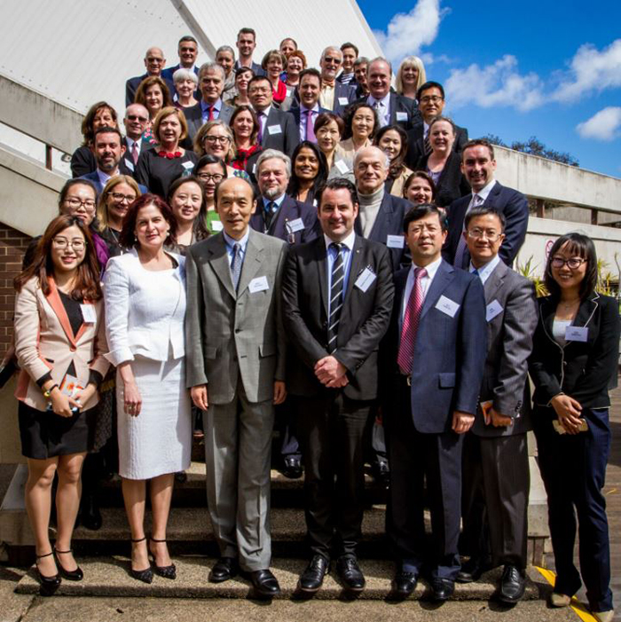 Group of attendees at Australia-China Cultural Dialogue, standing together outside on steps.