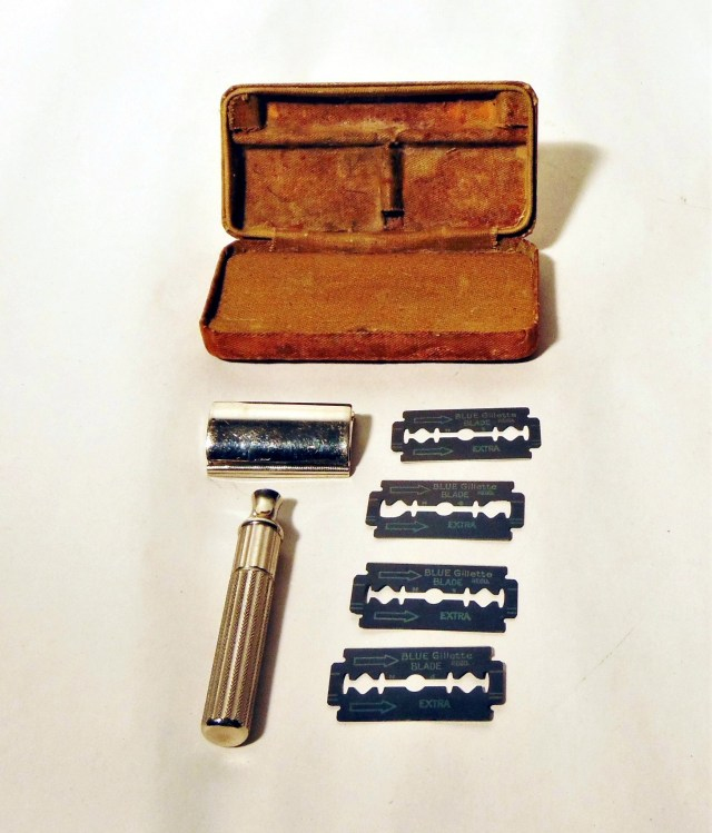 A 1932 Gillette shaving razor with three blades and storage box.