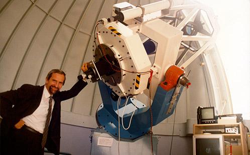 Open Day - Publicity Photograph - Professor Chris Duke standing near a telescope inside the Werrington Observatory 1997 (P3640)