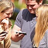 Young people on their mobiles