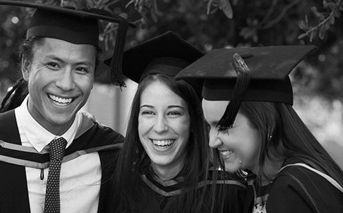 Graduates laughing
