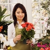 A young Asian florist in her flower retail shop