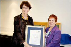 ViceChancellor Professor Janice Reid AM presents Councillor Helen Westwood AM