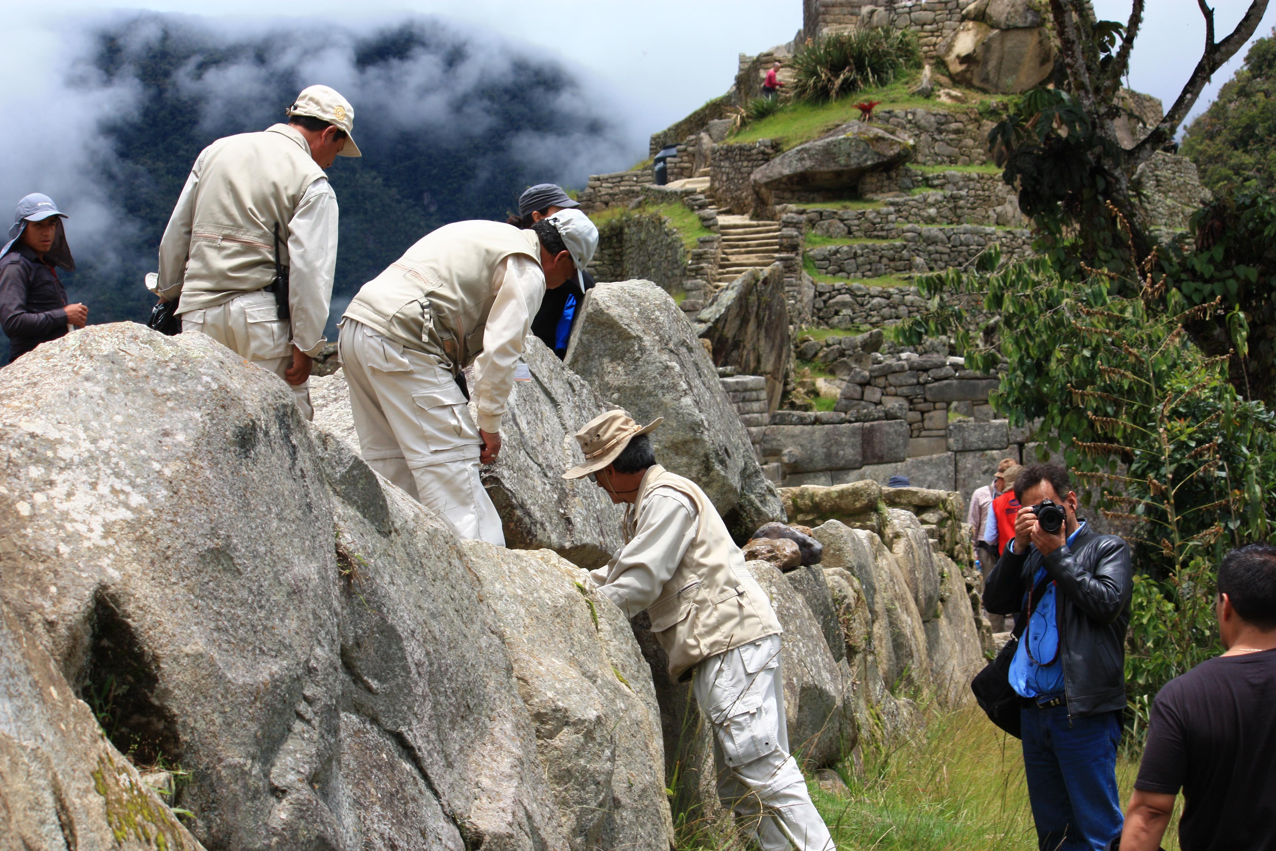Conservation staff inspecting stonework in Machu Picchu
