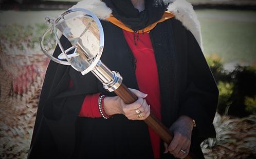 Holding University Mace