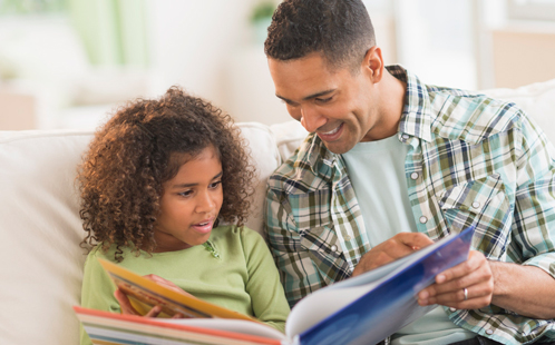 Child reading with parent