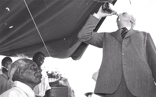Whitlam drinking beer