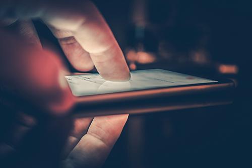 Hand touching smartphone.
