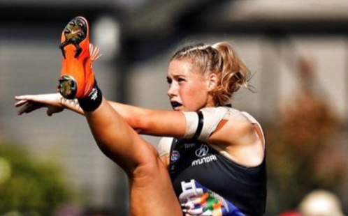 Tayla Harris AFLW in action kicking a football