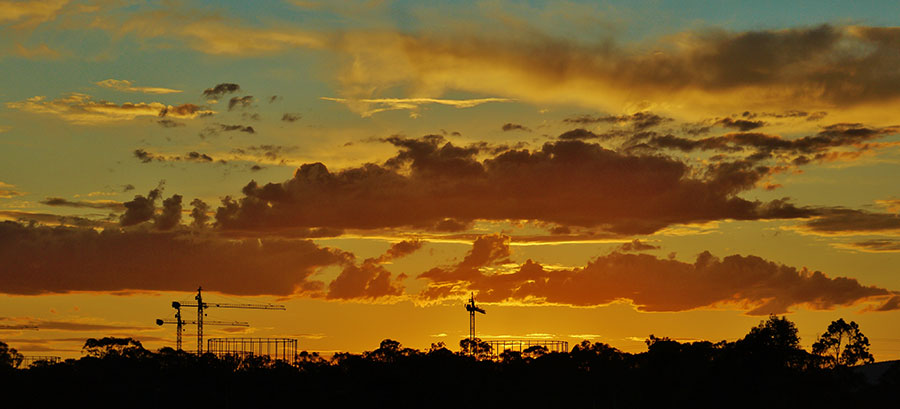 The EucFACE experiment's rings and cranes at sunset after a hot day