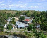 Village in amongst green hills in East Timor.