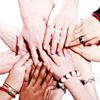 A group of peoples hands touching