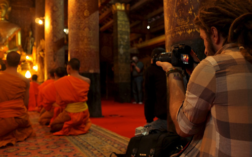 Monks being photographed