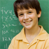 Teenage boy with a blackboard behind him with mathematical questions