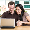 A young happy couple on a laptop