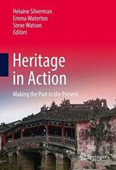 The cover of Heritage in Action which features a character home on the bottom and a red/pink sky above with the title of the book.