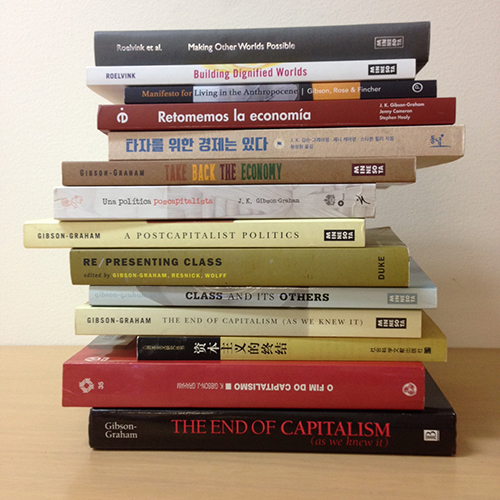A stack of 14 books relating to post-capitalist possibilities