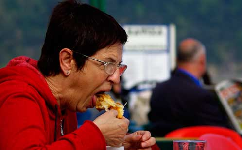 Woman eating pastry