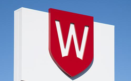 University shield  at campus entrance