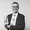 Thumbnail image of David Rowe with his award
