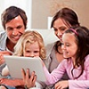 Thumbnail image of a family looking at a laptop