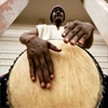Man playing a west African drum