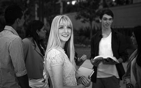 Female student amongst peers