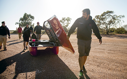 Seven News Young Achiever Awards finalist Aj Verma with the solar car
