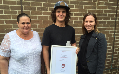 Taylor Jay Curry and his mum receive the award from Academy Director Jo Lind