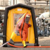 Air pressure tent with person in the protective suit