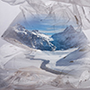 Thumbnail image of mountain within plastic water bottle
