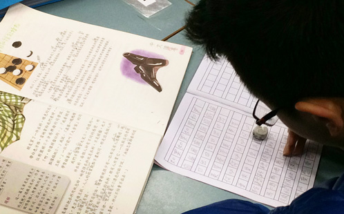 Student studying Chinese characters