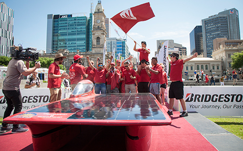 Solar Car team celebrate crossing finish line