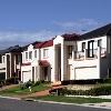 Suburban Street With New Modern Houses In A Sydney Suburb On A Sunny Summer Day, Australia