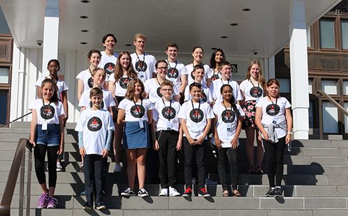 A group of 21 young people on the steps to the Museum of Australian Democracy