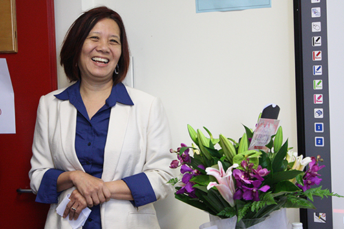 Ien Ang with her flowers at her farewell as Director morning tea.