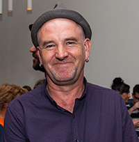 Profile photo of Enda Murray - wearing a purple shirt and grey hat.