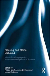Cover of Housing and Home Unbound with blue and white Routledge swirl pattern.