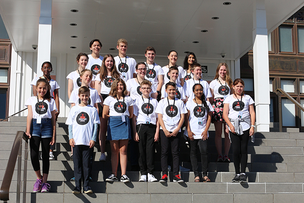 A group of young people on the steps of the Museum of Australian Democracy