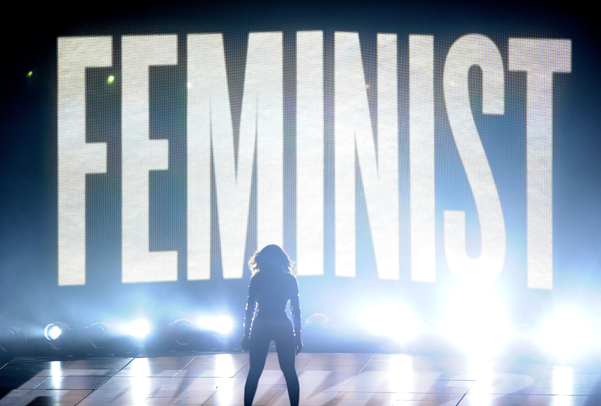 Image of Beyonce at the VMA's, her silhouette in front of text that reads 'Feminist