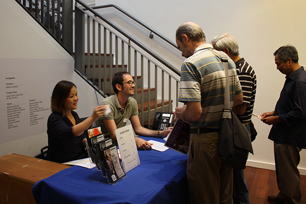 Guests register at the Chinatown symposium