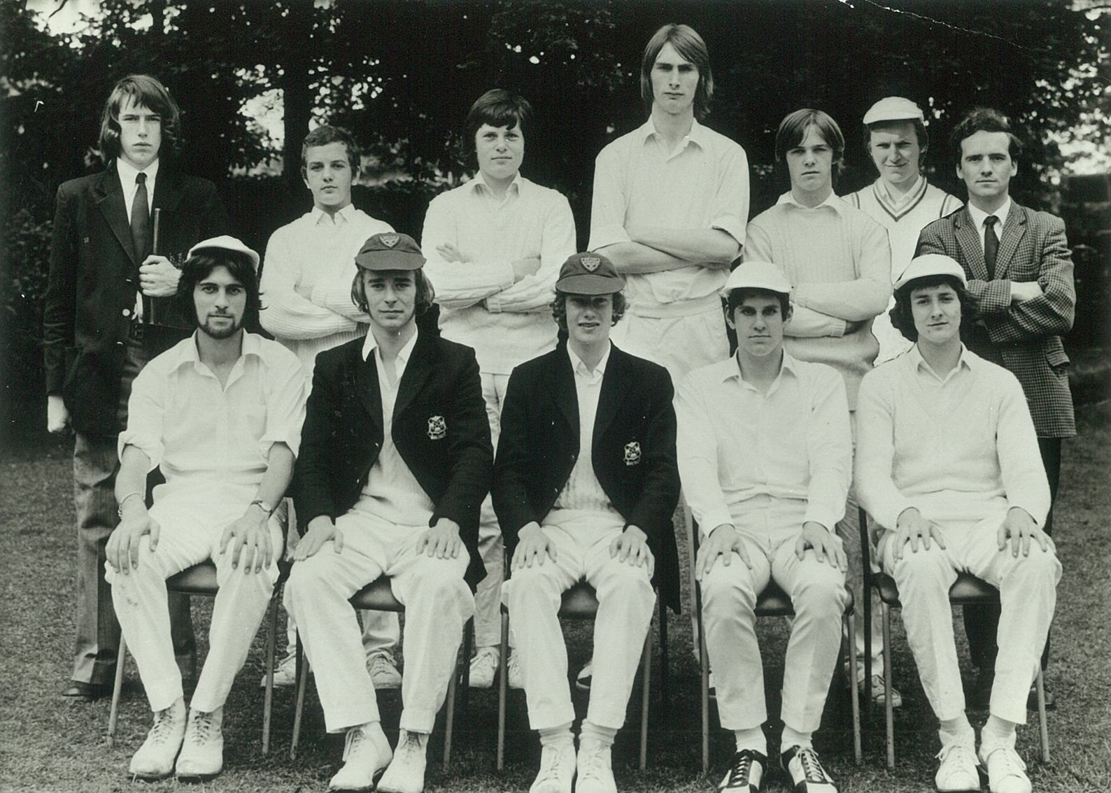 Black and white image of young men's cricket group posing for a photo