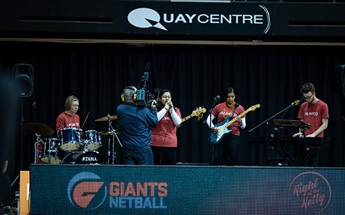 Western music students performing at GIANTS Netball
