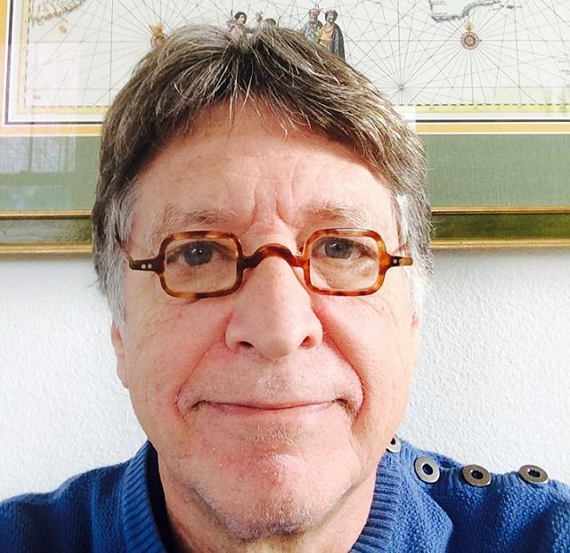 Close up of George Marcus wearing reading glasses