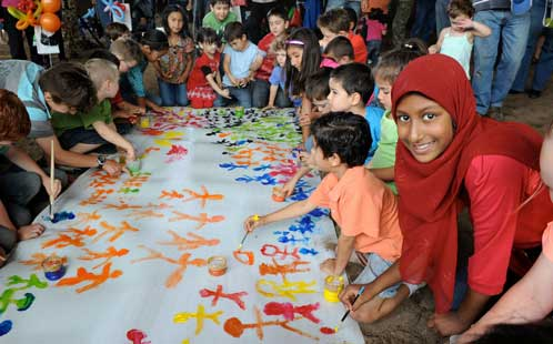 Children gather to paint and celebrate Harmony Day