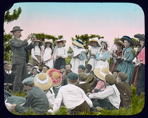 Charles T Musson, Lecturer in Botany and Entomology, giving a class outside to a group of school children [Hawkesbury Agricultural College (HAC)] c.1900 (P2745)