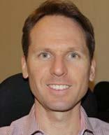 Close-up shot of Ian Tapuska wearing collared shirt
