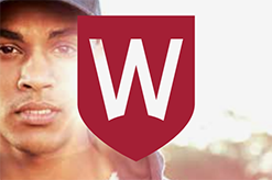 Man's face with university shield logo on top