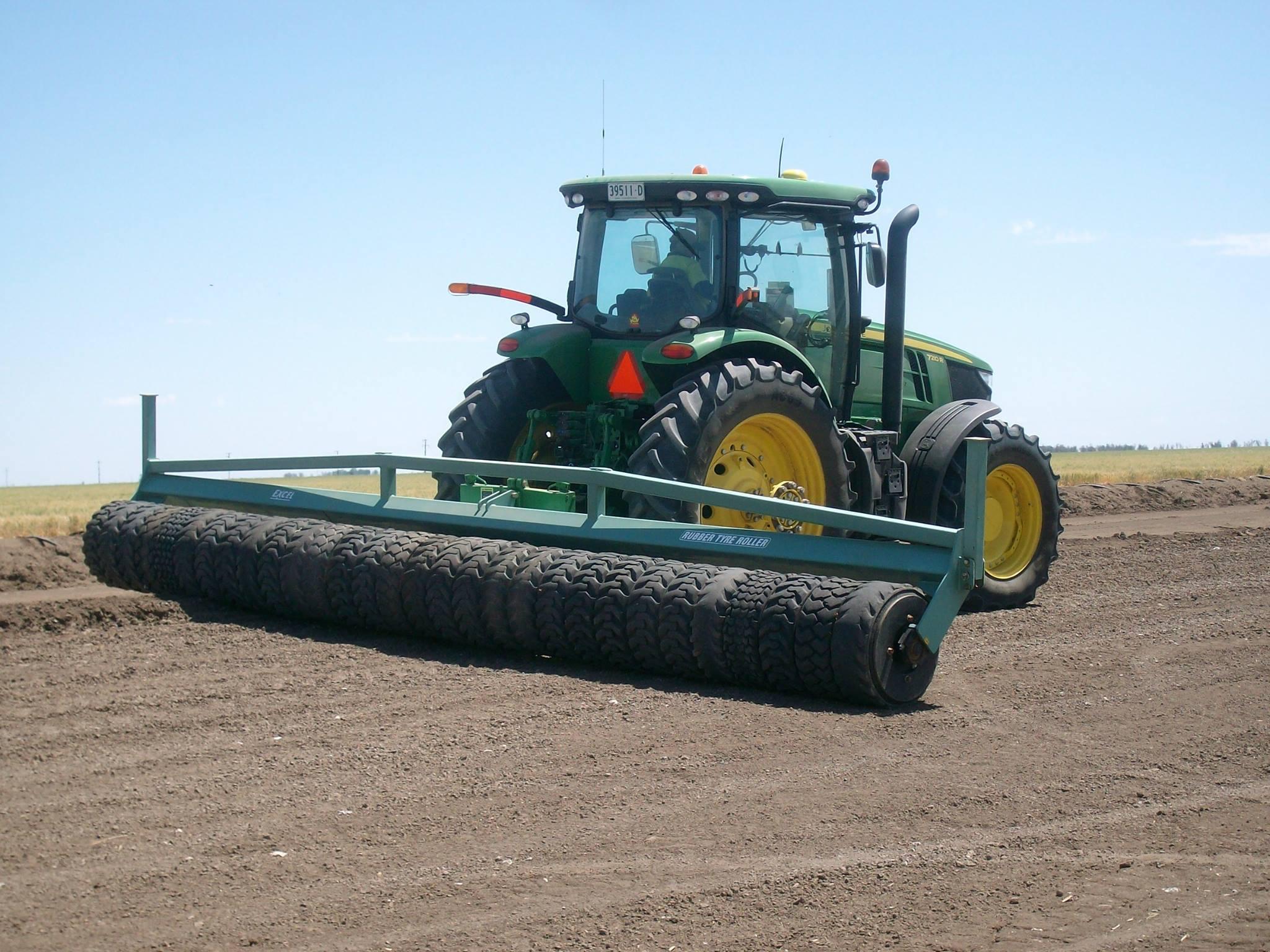 John Deeere tractor rolling soil