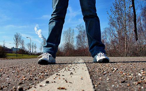 Feet on the sidewalk